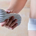 male hand holding tenga flex silky white sex toy